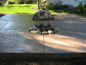 Patio with fire ring by Schumm Concrete